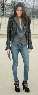 Barbara Martelo in a black leather motorcycle jacket + grey cardigan + skinny jeans + black ankle boots