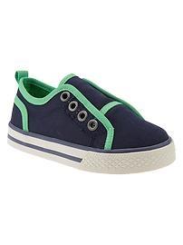 Cute sneaks. Neon trim slip-on sneakers