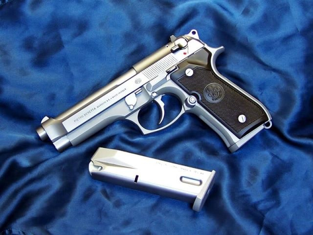 My new baby - Beretta 92fs INOX 9mm! Find our speedloader now! http://www.amazon.com/shops/raeind
