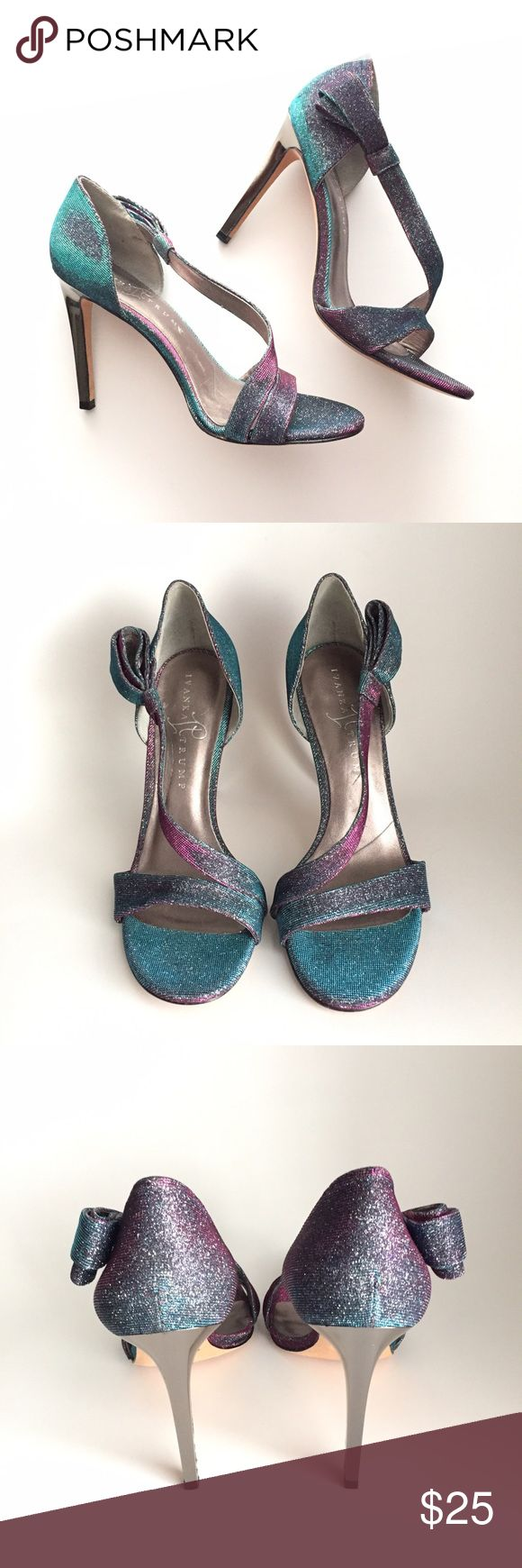 🔹Ivanka Trump🔹Cecily sandals The iridescent Cecily shoe from Ivanka Trump. Made of blue rose glitter mesh with bow detail at the ankle. Excellent condition, no scuffs -- any darker areas in photos are just the effect of the lighting on the material. No scratches on the heel. Only used once for a wedding. 4 inch heel. Ivanka Trump Shoes Heels