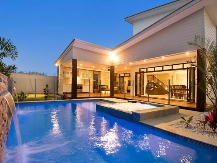 Geometric pool design using tiles with cabana & waterfall - Pool photo 1373697