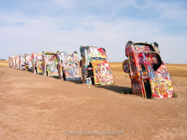 Amarillo, TX - 2004 : At the Cadillac Ranch, writing graffiti on or otherwise spray-painting the Cadillacs is encouraged.