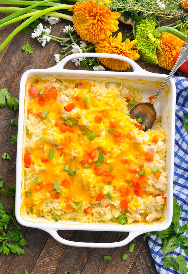 This amazingly delicious Dump-and-Bake Fiesta Chicken and Rice Bake is an easy dinner that cooks entirely in one dish -- without any prep work! Chicken Breast Recipes | Easy Chicken Recipes | Easy Dinner Recipes
