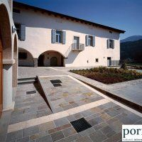 """""""Palladium Plus"""" Porphyry tiles with natural surface, sawn sides, mixed color."""
