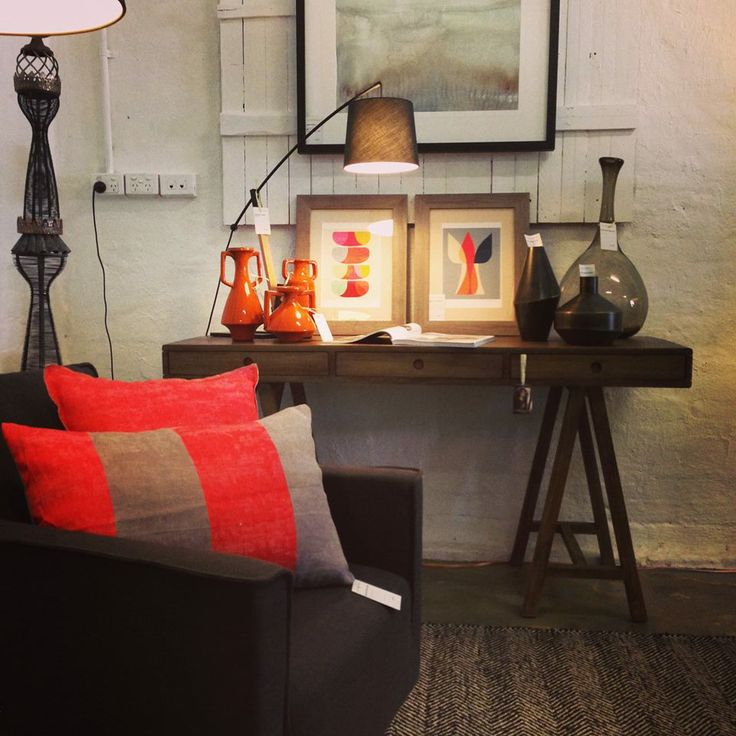 Rich and dark: Fiery reds and oranges with dark chocolate and industrial textures. Sculpture by Theo Koning.