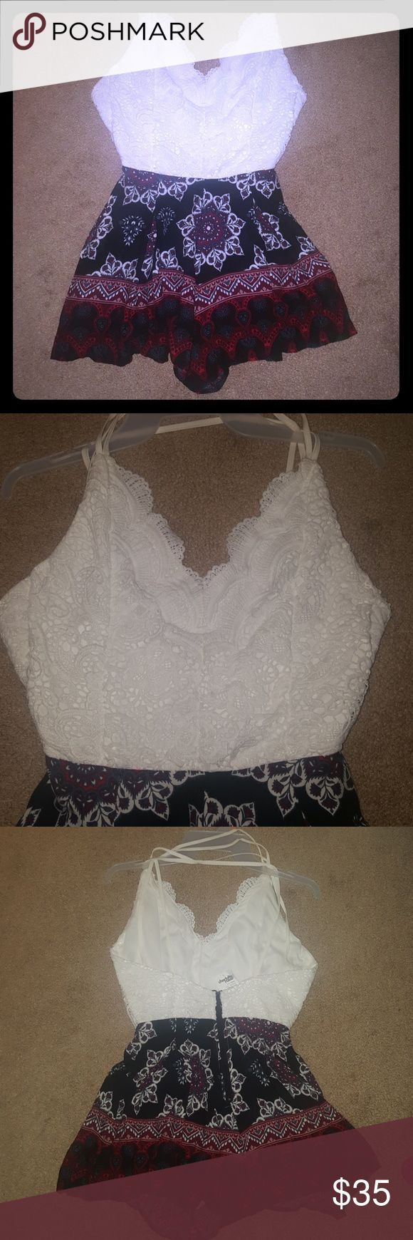 Beach Travaler White Lace/Paisley Romper NWT White knitted lace backless top. The bottom is light weight Flowy Summer paisley material. Very sexy and cute for the summer beach or a night out. It has a zipper in the back for easy putting on and removing of the item. Charlotte Russe Dresses Backless