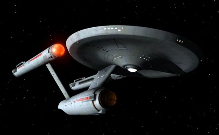 Starship Enterprise NCC 1701.  A Constellation class heavy cruiser, this is the ship from Star Trek, the original series.  She is armed with photon torpedoes and phasers, and defended by shields.