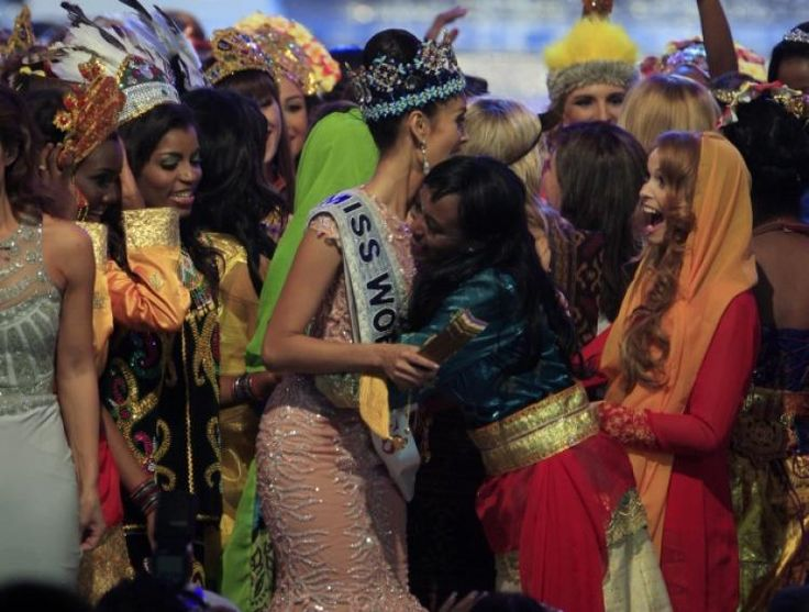 Newly crowned Miss World 2013 Megan Young of the Philippines, center, is congratulated by other contestants.