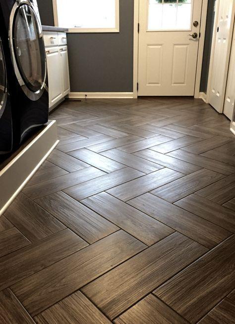 Mudroom flooring. Gray, wood grain tile in herringbone pattern.