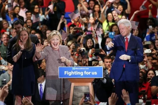 Democratic presidential candidate Hillary Clinton walks on stage with her husband Bill Clinton, daughter Chelsea Clinton and son-in-law Marc Mezvinsky after winning the highly contested New York primary on April 19, 2016 in New York City.