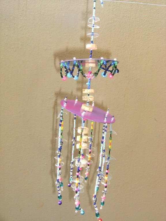 Random hangy thing made for my grandaughter, Isabella, using old CD's, corks, soda bottles etc...