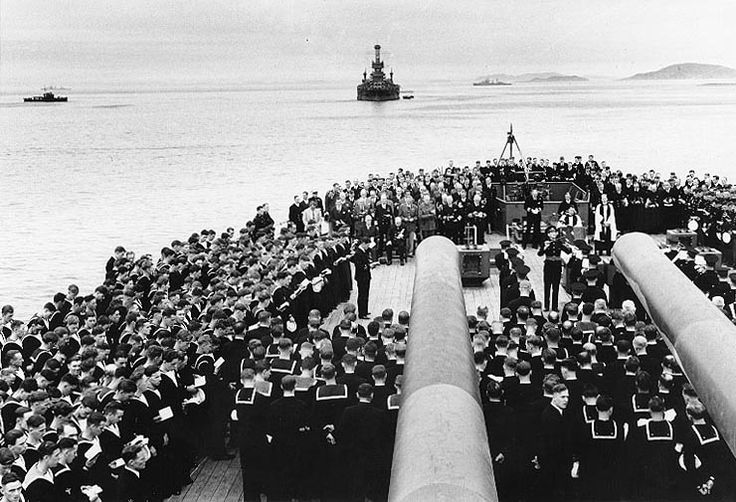 Religious service on board HMS Prince of Wales during Atlantic Charter Conference, Placentia Bay, Newfoundland, 10 Aug 1941; note Roosevelt, Churchill, King, Marshall, Dill, Stark, and Pound in presence; USS Arkansas in background