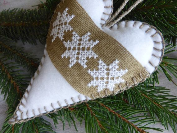"Felt heart with burlap cross stitch decoration. The white stars are hand embroidered with a cotton thread. Dimension: 5,5"" x 4"" without string"