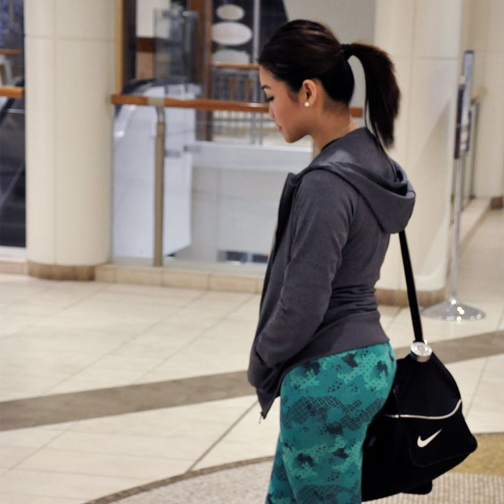 """""""Have you hopped on the patterned leggings trend yet? I just did with these Puma leggings – the print and the color are incredible. If you're not quite ready to take the plunge on brights, just start with one piece and pair it with neutral colors. These leggings got me pretty hyped walking through the mall after the gym."""" - Anna"""