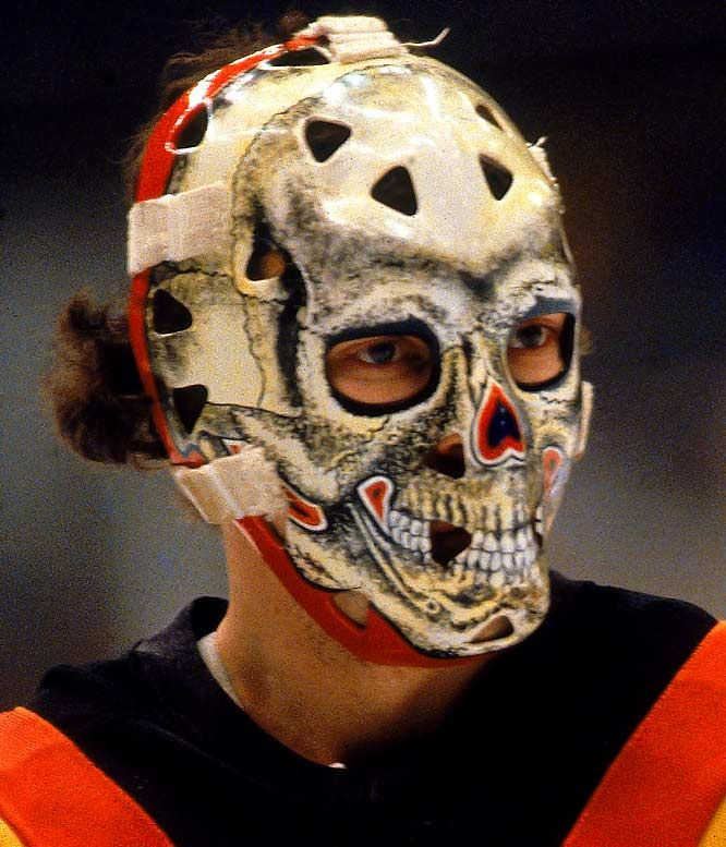 The Canucks' Gary Bromley sports the official goalie mask of Halloween! That's old-time hockey.