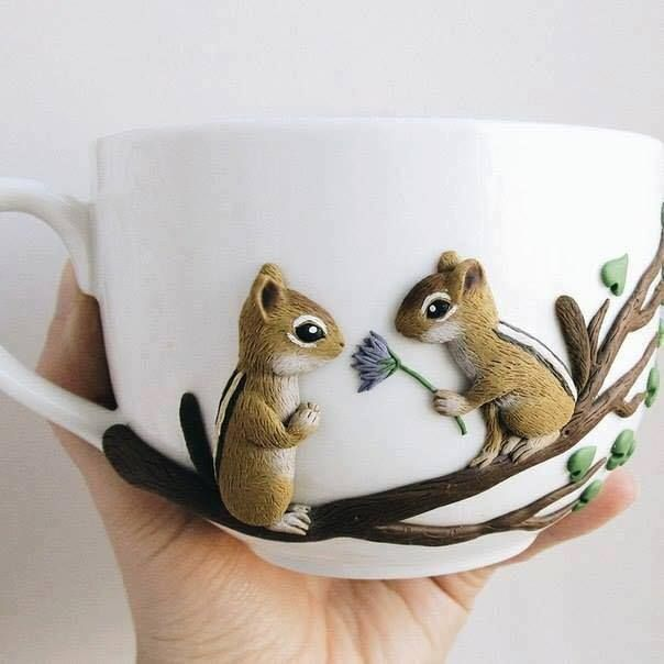 Polymer clay chipmunks on a branch