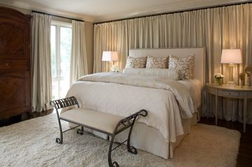 wall to wall curtains behind the headboard
