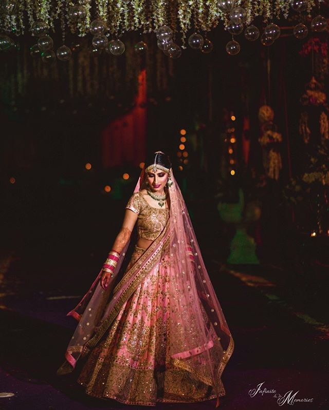 Day weddings are gorgeous , but there's something about twirling under bed of lights ! Shot by @infinite_memories09 #lehenga #twirling #indianbride #bride #brides #wedding #indianwedding #pink #indianwear #ethnicwear #pinklehenga #brides #bridal