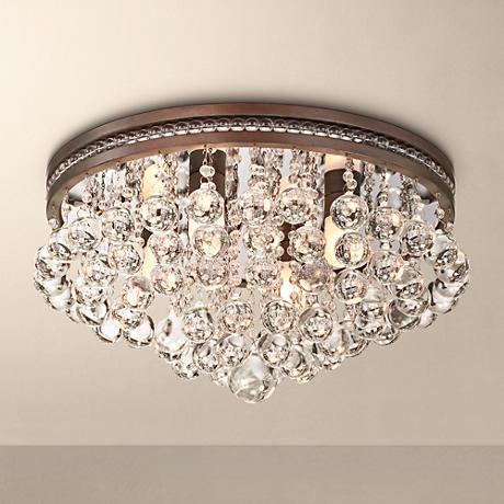 It's raining crystals with this flushmount ceiling light comprised of clustered clear crystal drops and olive bronze finish.