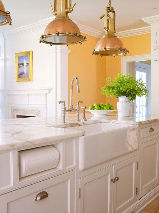 Built in paper towel holder; brass pendants; farmhouse sink; bridge faucet