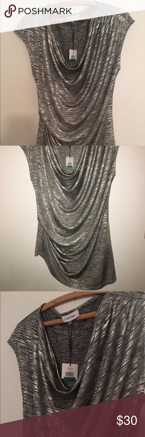NWT Calvin Klein metallic blouse Brand new with tags Calvin Klein tank top. Never worn. Gorgeous tank top! Grey and silver metallic. Comfy stretchy material.  Classy and gorgeous!   #calvinklein #tanktop #metallic #brandnew #newwithtags #nwt #neverworn #womens #cowlneck #spring #summer Calvin Klein Tops Blouses