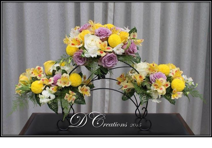 Triple arrangement on stand of mums, purple roses, Peruvian lilies