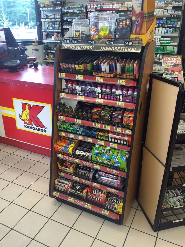 Shoppers at this Kangaroo Express must face a rack of candy at checkout. More toys, no candy, please! (Kangaroo Express, Wilson, NC, 8/15)