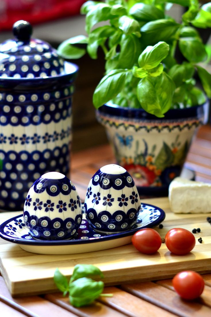 Salt and pepper shakers on the stand. Beatifully apears on the table. Made of natural ceramic clays, hand formed and hand decorated by Bolesławiec artist.