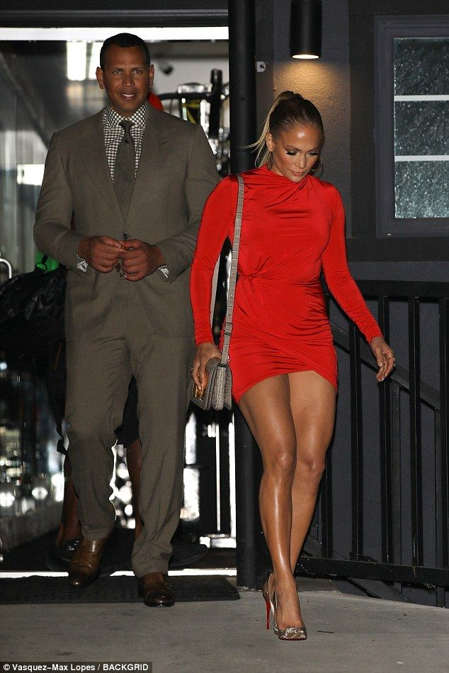 1e8b4e618c7 Stunner: The 48-year-old star showcased her legs in a figure-hugging, fiery red  dress