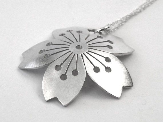 The pendant is Sterling Silver and has been domed to give it a more 3D feel. It measures approx. 30mm/1.2 across and has been hand cut.  PLEASE NOTE: THIS PENDANT DOES NOT COME WITH A CHAIN  Shipping Options: International:Airmail (approx 5-7 days for USA, 5 days for the UK and 10 days for Canada & approx.7-10 days for Europe; please check with me for other destinations) Australia: Express Post  ©Ceeb Wassermann, 2016. The moral rights of the designer are asserted.