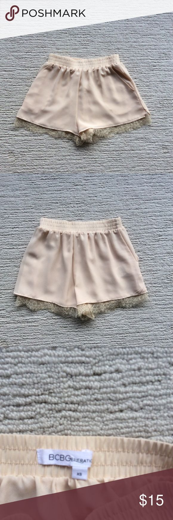 BCBG GENERATION SHORTS Great shorts have elastic waist, Size XS, lined with pockets, with lace hangs down really very feminine and soft look. Like new! BCBGeneration Shorts
