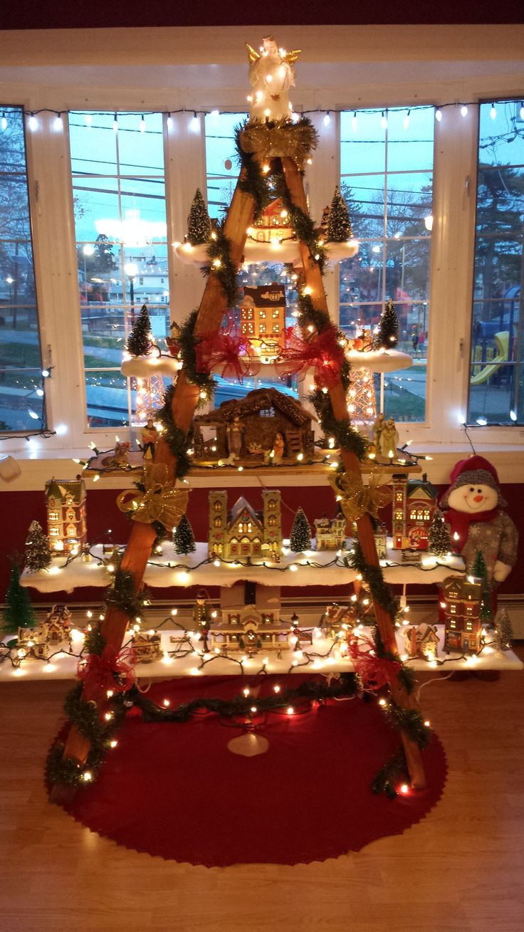 This is a little different but is such a unique idea. For those with limited space you can create a space to display your Christmas village scene, nutcrackers, music boxes, etc. A simple old ladder…