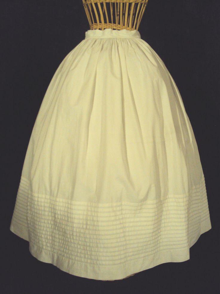 "White Civil War 1860's Skirt– Petticoat Excellent Condition | eBay seller mssemmy, heavy cotton, 14 rows of tucks at hem, shell button at waist, waist: 26"", length: 38.5""; hem width: 108"""
