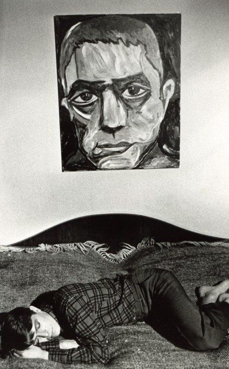 A young David Bowie sleeping in front of his painting of Yukio Mushima