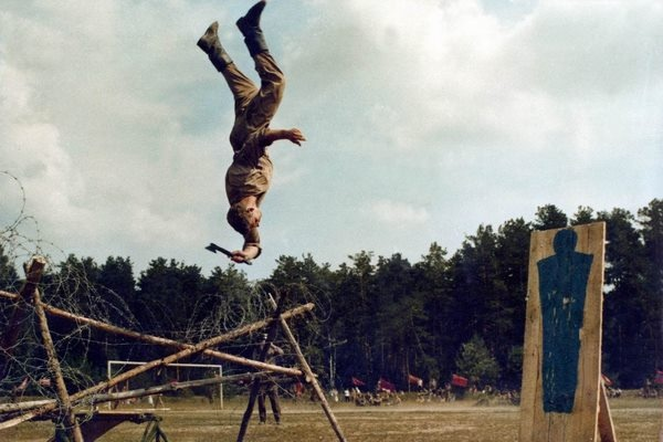 Picture of a Russian Spetsnaz Soldier during training, back flip while throwing a hatchet. And yes it is a real picture, another one shows a Spetsnaz throwing a knife in the same manner.