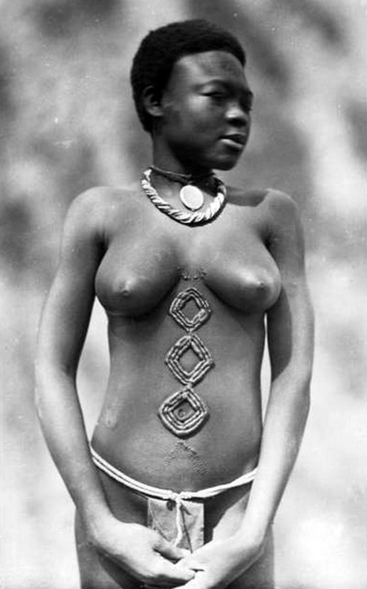 Africa | Young girl with scarification. || Scanned vintage postcard; photographer C Zagourski.