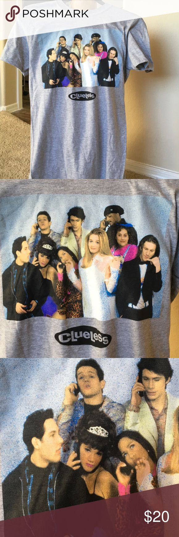 """CLUELESS Tee SHIRT NEW solid GRAY cast design S Vintage look tee original cast of CLUELESS ALicia Silverstone front & center.Made of Poly cotton Blend short sleeved. Halloween coming may be part of your costume.... Small ... 18 3/8"""" underarm - underarm..28"""" shoulder to hem UNISEX have other sizes... Clueless Tops"""