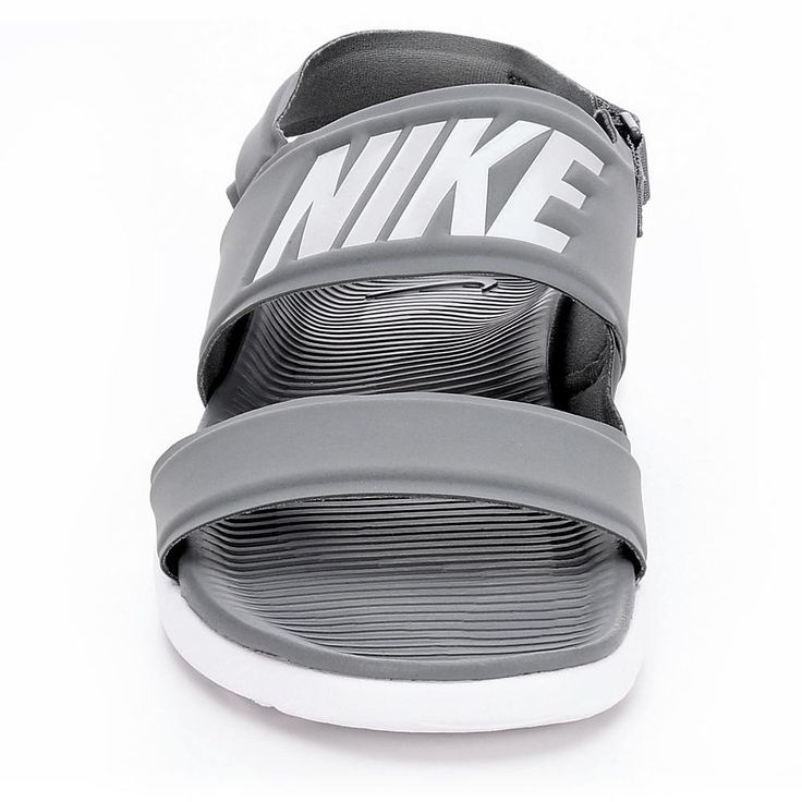 Description: Nike Tanjun Women's SandalAdd an athletic twist to your spring and summer look in the Tanjun women's sandal from Nike. A soft neoprene upper create