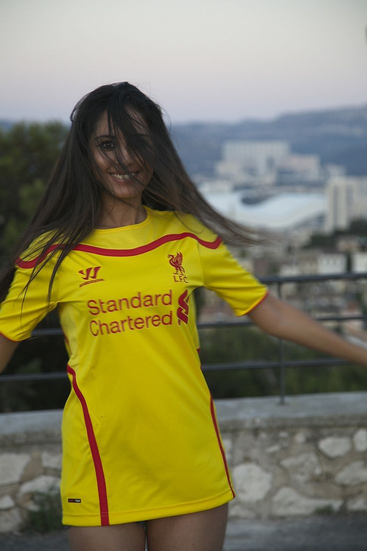 Marseille Velodrome. Liverpool girl posing in the yellow away kit. Hot smile - lots of hair. Pure football.