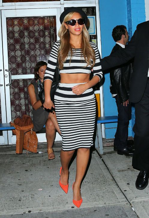 Beyonce. Matching striped crop top and high waisted pencil skirt, bowler hat and red pumps