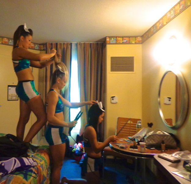 And when your mom wasn't around to help do your curls, your teammates stepped in. | 35 Things Every Cheerleader Will Understand