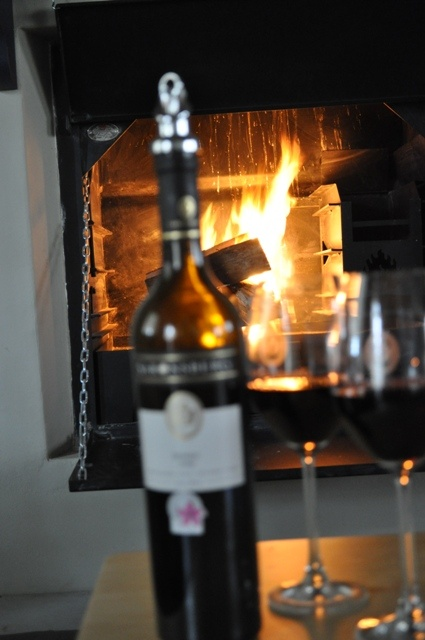 relax in front of the fireplace with a glass or two of our award winning wines at Saronsberg Vineyard Cottages, Tulbagh