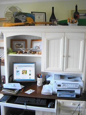Add a hutch above your desk to add more storage space in your home office {featured on Home Storage Solutions 101}