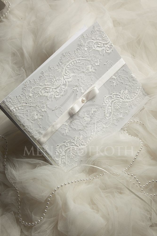 Elegant wedding guest book with French lace and channel bow #weddingguestbooks #lacewedding
