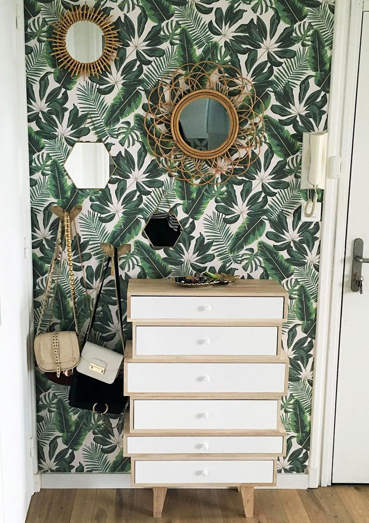 Banish ordinary walls with this tropical wallpaper design. The rattan mirrors…