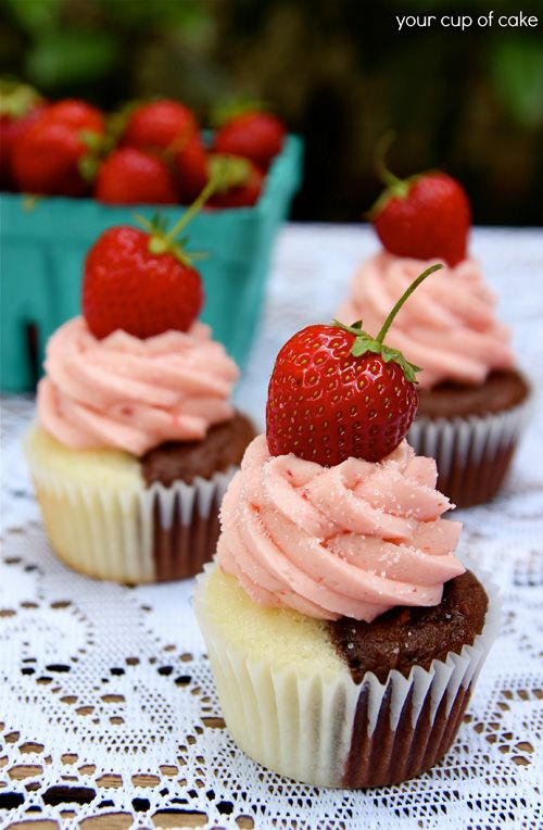 Neapolitan Cupcakes  Chocolate Cake: Devil's Food Cake mix 3 eggs ½ C oil 1 C milk 1/3 C sour cream 2 t vanilla extract  Vanilla Cake: 1 White Cake mix 3 eggs 1/3 C oil 1 C milk 1/3 C sour cream 1 T vanilla extract  Strawberry Buttercream: 2 C butter, softened ¼ C strawberry puree (to make puree, blend your berries in a blender) 2 t vanilla extract 6-8 C powdered sugar