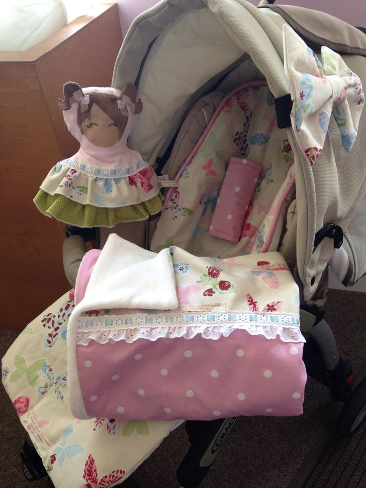 Pretty girls cosytoes pram liner and matching blanket, dolly and hood bow set! Also comes with a matching bag. Handmade with Seren Bach Designs.
