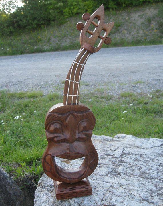 Hey, j'ai trouvé ce super article sur Etsy, chez https://www.etsy.com/ca-fr/listing/469632261/bois-sculpte-guitare-acoustique-guitare
