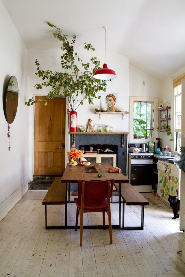 I like the extra shelf above the fire place, the big branches and the mural on the drawers.