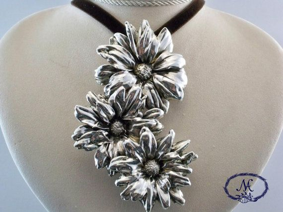 Real #Daisies covered with a #925 silver foil  di #NaturaArgento, €80.00  #artisancraft #handmadejewelry